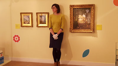 Curator of exhibitions at Leeds City Museum Ruth Martin with John Atkinson Grimshaw paintings.