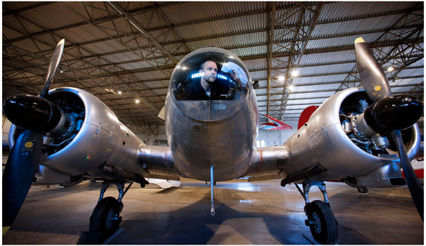 Conservator Thilo Burgel cleans up the nose cone of an Avro Anson aircraft at the newly redeveloped civil aviation hangar at the National Museum of Flight, East Fortune Airfield  © Paul Dodds.