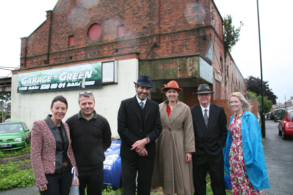 Exterior of the former cinema at Ryhope, Sunderland with Beamish staff and former owners.  The cinema will be removed and redisplayed at Beamish.