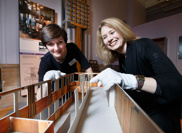 Curators Joanna Norman (V&A) and Alison Brown (Glasgow Museums) with a scale model of the Oak Room.  The huge former tearoom will become part of V&A Dundee when it opens in 2018.