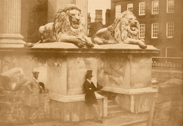 Builders by the Fitzwilliam Lions courtesty of the Fitzwilliam Museum