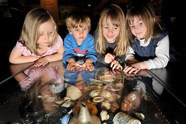 Children look at objects in the underfloor cases in the Expanding City gallery at the Museum of London.  Courtesy of the Museum, one of the images from Museums Matter.
