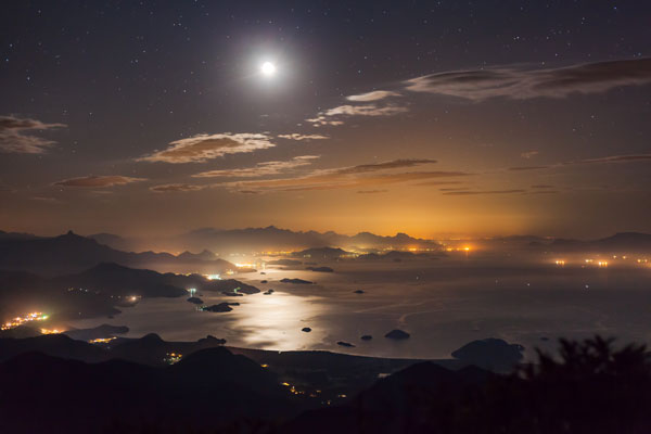 Moon Reflection © Rafael Defavari (Brazil) The brilliance of the Moon illuminates the night sky, and is reflected in the expansive water of the Paraty Bay, Brazil. Like all this month's images, it is shortlisted for the Royal Observatory's Astronomy Photographer of the Year