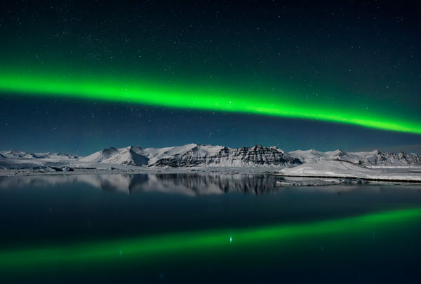 Northern Lights over Jokulsarlon, Iceland © Giles Rocholl (UK) Northern Lights streaking across the night sky over the lagoon at Jokulsarlon, Iceland on Valentine's night of 2016