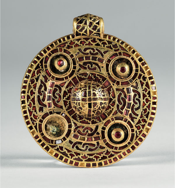 anglo saxon brooch with red inlay